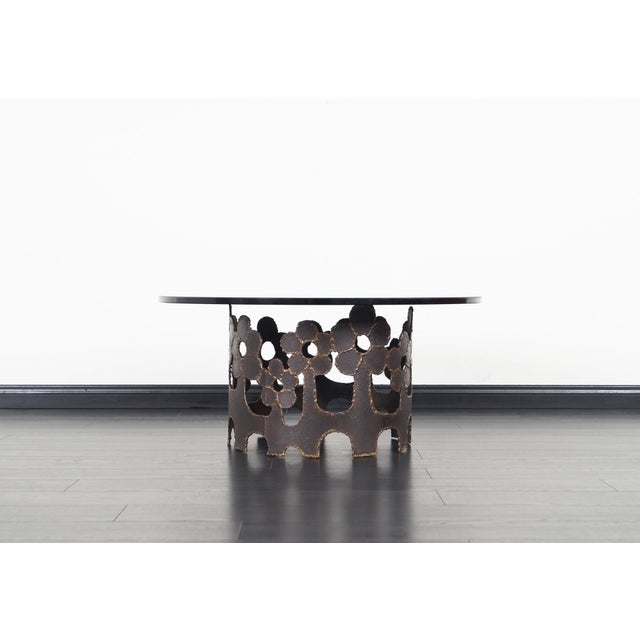 Vintage bronze coffee table designed and manufactured in the United States, circa 1970s. Features the original smoke glass...