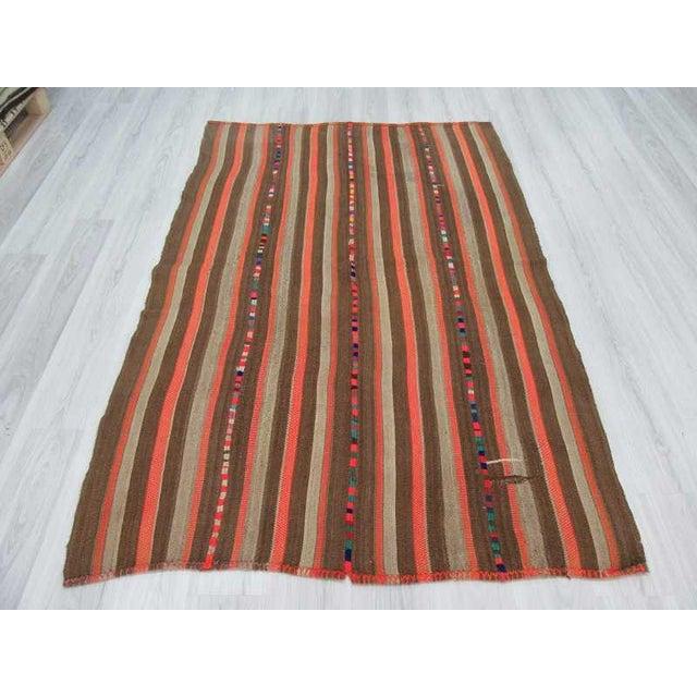 Vintage Brown and Orange Striped Decorative Turkish Kilim Rug - 4′9″ × 7′3″ - Image 4 of 6
