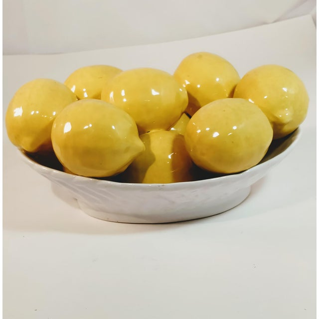 Bright and cheerful yellow lemons in a white bowl. The lemons are 3D and look very life like. I believe there are 11 full...
