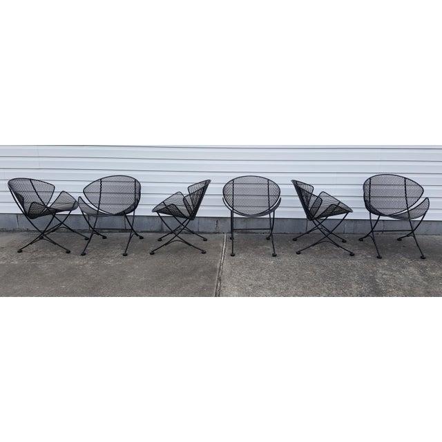 I currently have 6 John Salterini (Maurizio Tempestini) mid century clamshell/orange slice/potato chip/ patio chairs...