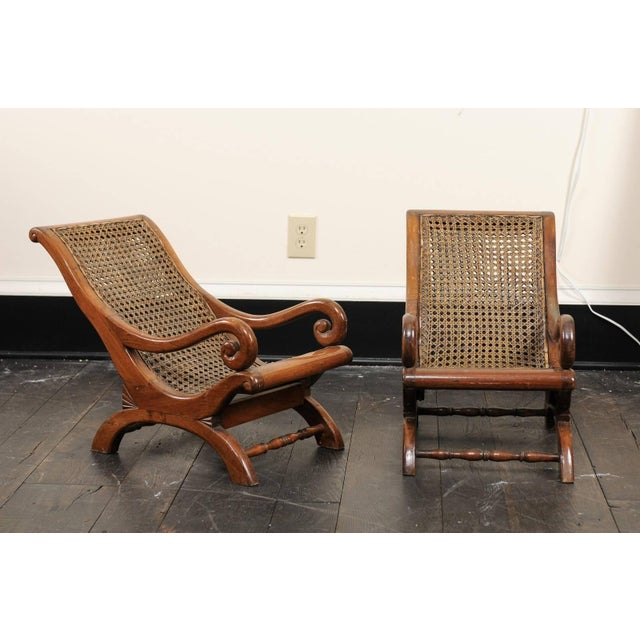 Pair of 19th century English children's chairs. This pair of antique English chairs feature cane seat and backs with curvy...