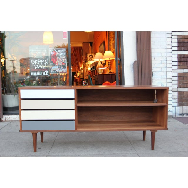 Really amazing, beautiful and useful American-made walnut credenza. Made right here in beautiful sunny Los Angeles.