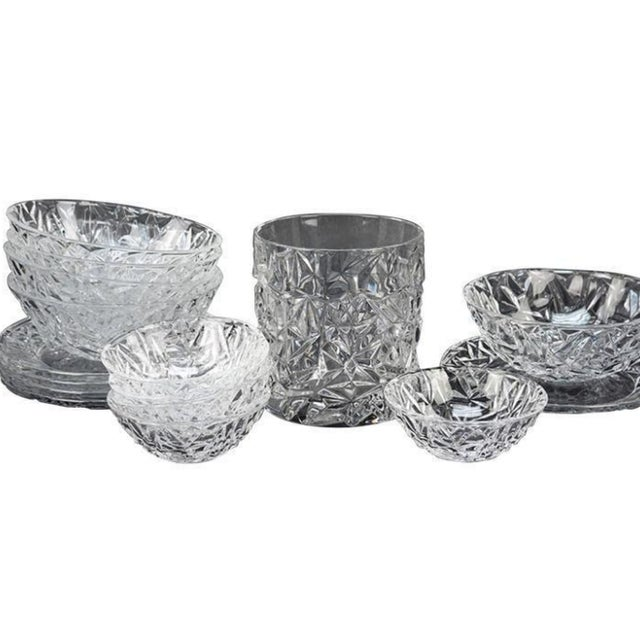 Collection of tiffany crystal in the rock cut pattern. Ice bucket, five large bowls, five smaller bowls and five plates.