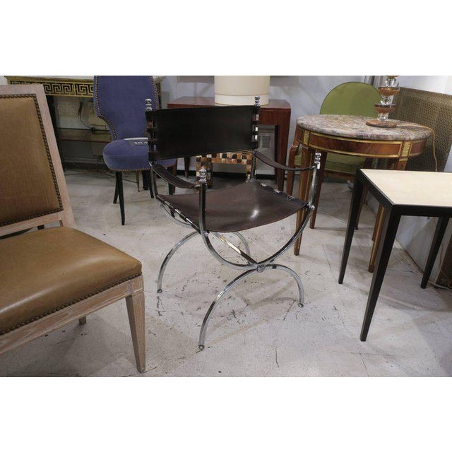 Pair of chrome and leather directors chairs attributed to Maison Jansen.