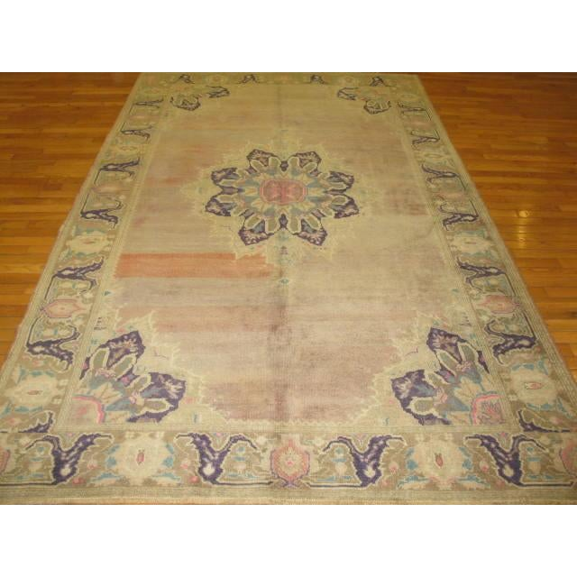 This is a unique and beautiful vintage antique washed hand knotted rug from Sparta, Turkey. The rug has a very simple...