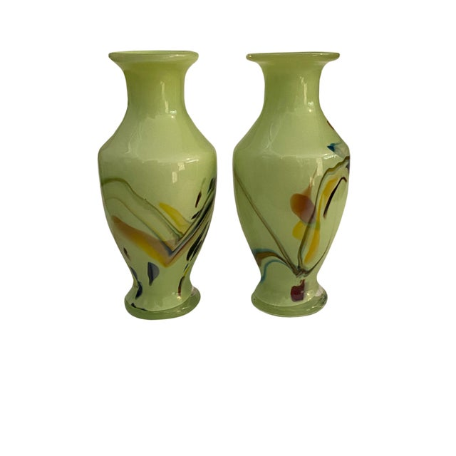 A pair of Italian art glass vases in a perfect for Summertime green. Cased glass with swirls in yellow, blue and brown.