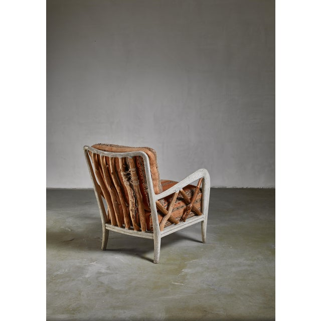 A Guglielmo Ulrich lounge chair restored in a 'folk art' manner with wood sticks. Combined with the kilim upholstery makes...