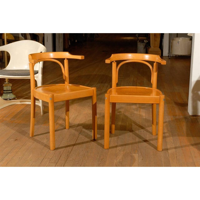 Pair of midcentury beechwood chairs with preforated seats in the style of Hans Wegner.