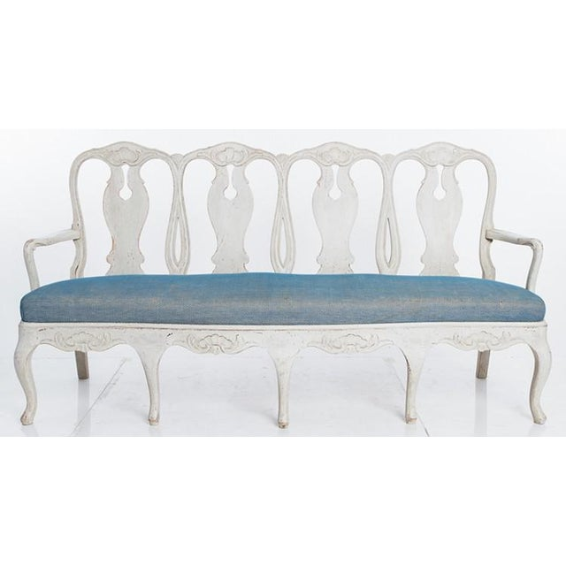 The back of the bench is a classic design, and the paint a very typical Swedish gray. Circa 1880. With its first paint....