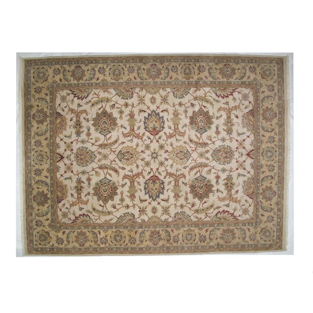 Beige wool pile Persian Zeigler style carpet hand woven in India.