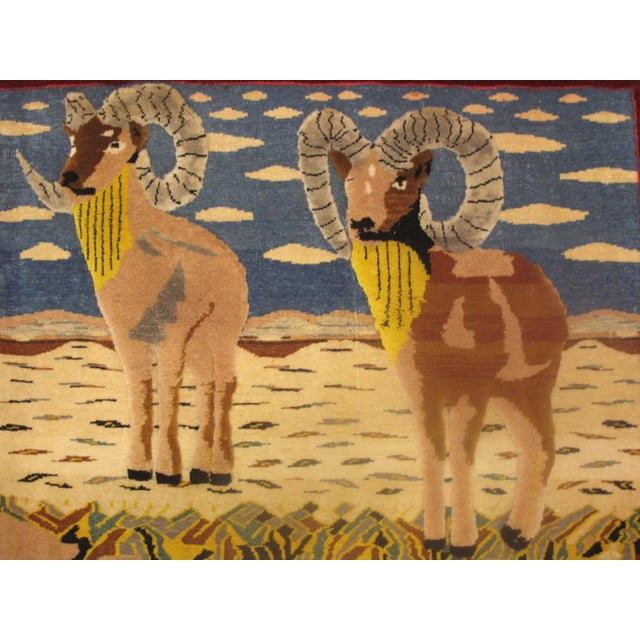 Unusual hand tied pictorial carpet depicting a pair of big horn sheep or rams. Finely knotted, mid 20th c, Excellent...