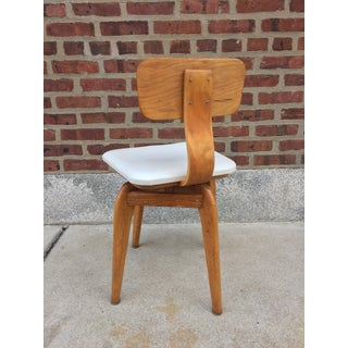 Mid Century Modern Refinished Blonde Swivel Chair Preview