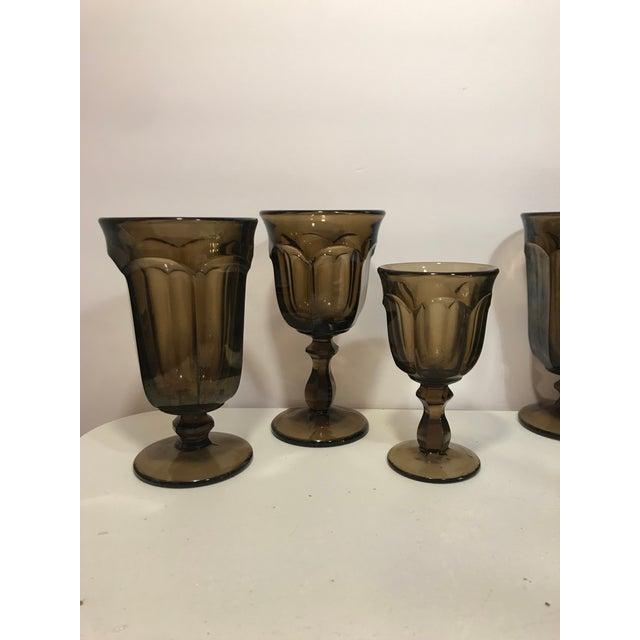 Mid-century 16 piece Old Williamsburg nut brown glass goblet drinkware set. Set includes 7 ice tea goblets, 6 wine...