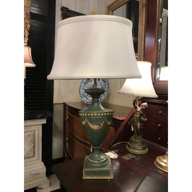 Blue tole urn lamp with white silk shade.