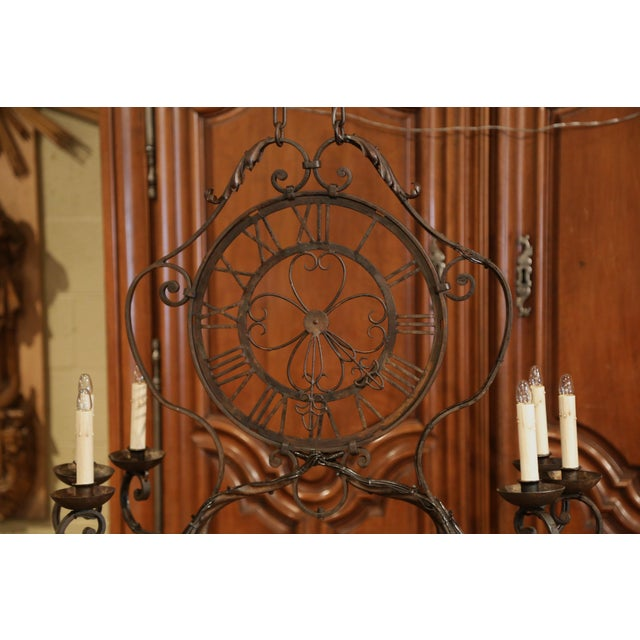 This elegant, antique chandelier was crafted in France, circa 1920. The oblong iron fixture features six newly wired...