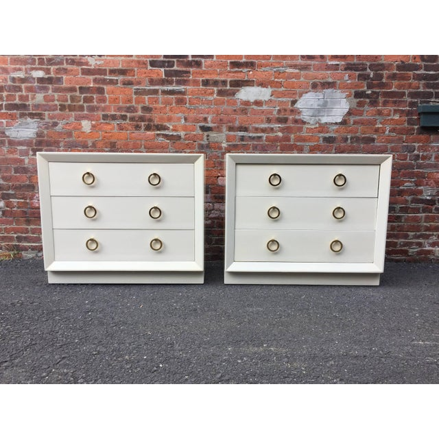 Pair of Terence Harold Robsjohn-Gibbings (1905-1976) dressers for Widdicomb. Deep three drawers with solid brass ring...