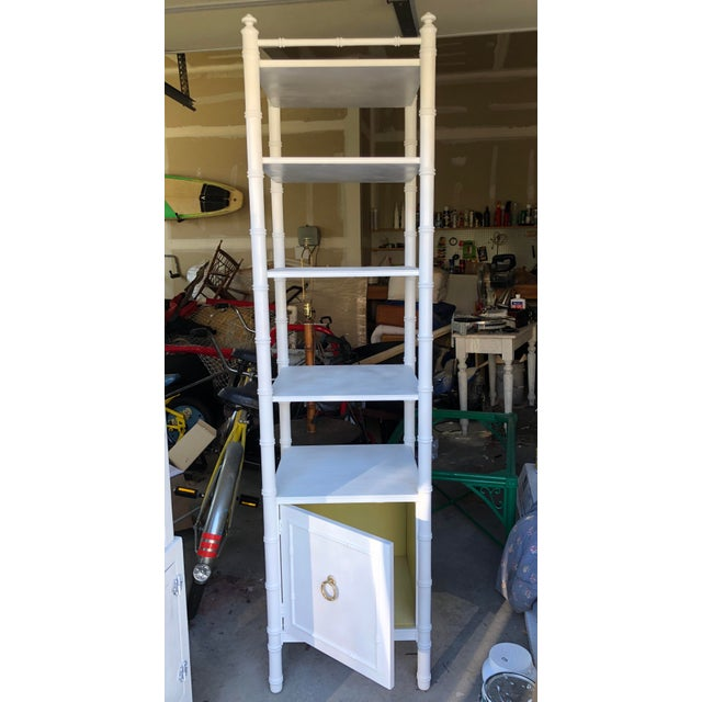 Stunning faux bamboo vintage etagere in white with gold door pull. It is in very good condition. It is missing a finial...