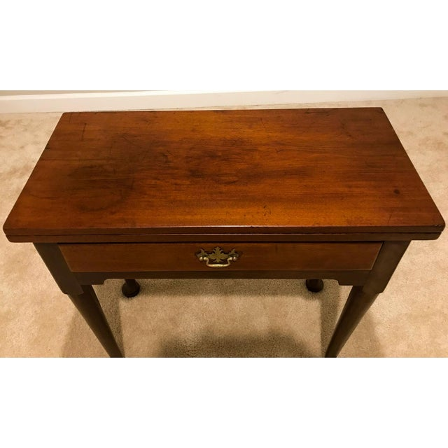 This is a great little card table that would be a great addition to any room. It is mahogany veneer, with oak in...