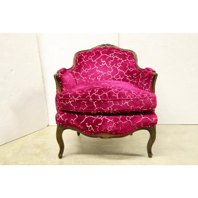 Lovely petite French bergere chair. Newly upholstered in a Designer's Guild raspberry pink cut velvet fabric. Goose down...