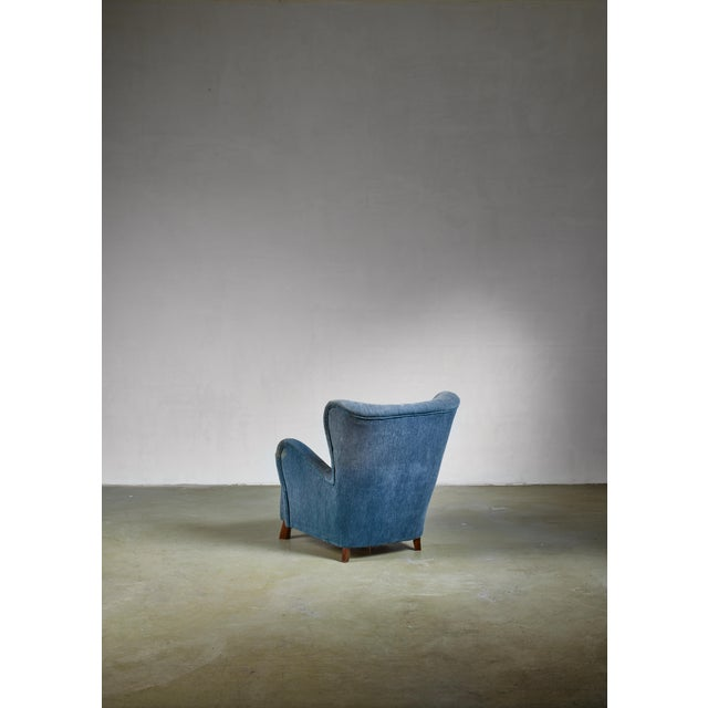 A lounge chair designed by architect Otto Schulz for his company Boet, Gothenburg, 1930s. The chair stands on stained...