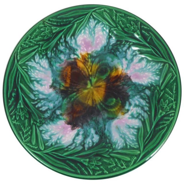 19th century English plate with clover in the centre surrounded by lilies.