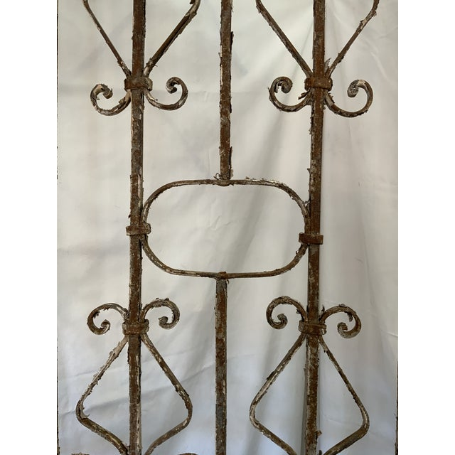 This spectacular iron gate has classic lines and shows beautiful scroll work throughout! The elegant iron design is turned...