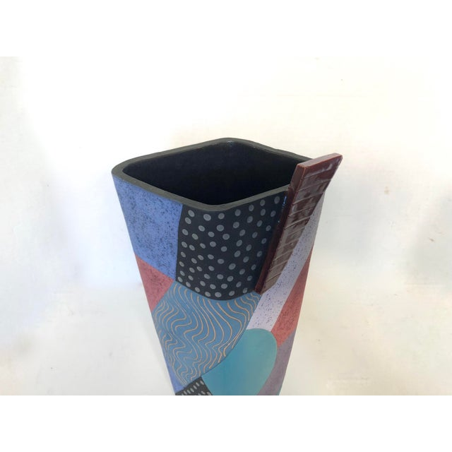 Unique piece of 1980's Memphis styled studio pottery. Features irregular shape with a blocked geometric pattern done in...