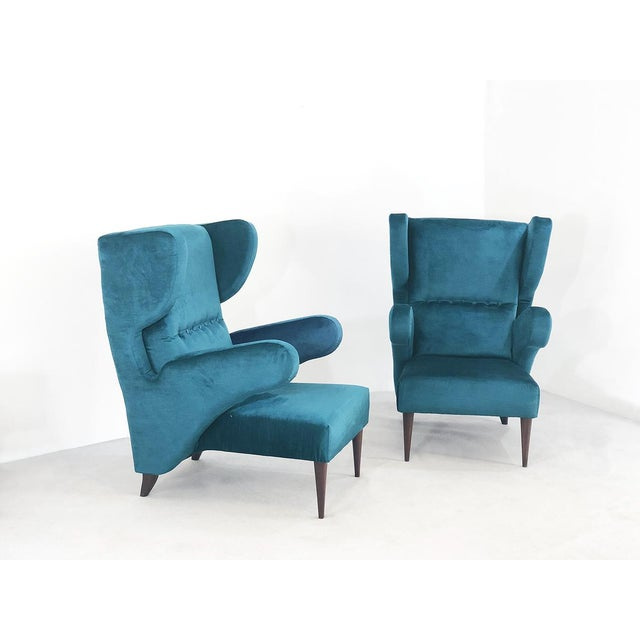 Pair of 50s armchairs attributed to Melchiorre Bega. The armchairs have been upholstered in turquoise silk velvet. The...