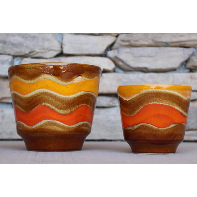 Add the perfect pop of color to your indoor or outdoor decor with this matching set of two decorative Fat Lava glazed...