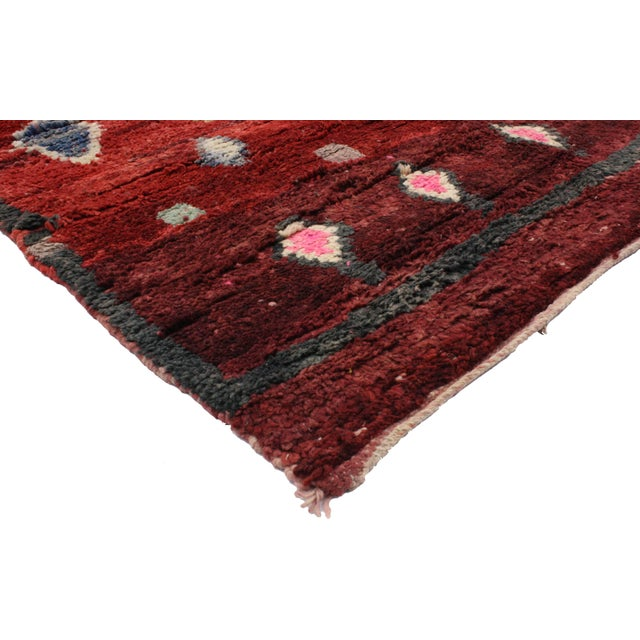 Impeccably woven from hand-knotted wool and free-form designs, this Berber Moroccan rug features a modern tribal style...