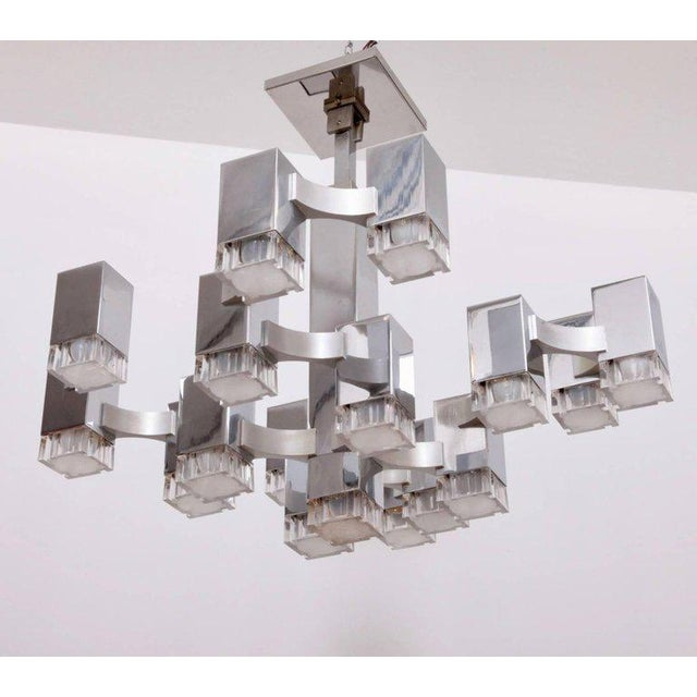 """Seventeen-light """"Cubic"""" chandelier by Gaetano Sciolari. Polished chrome housing with brushed chrome arms with original..."""