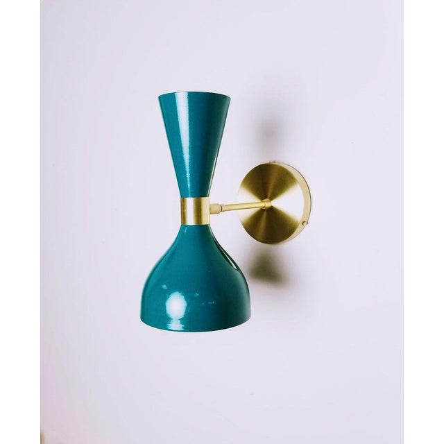 """Our best-selling LUDO wall sconce or reading light shown in natural brass and our popular """"Denmark"""" rich blue green..."""