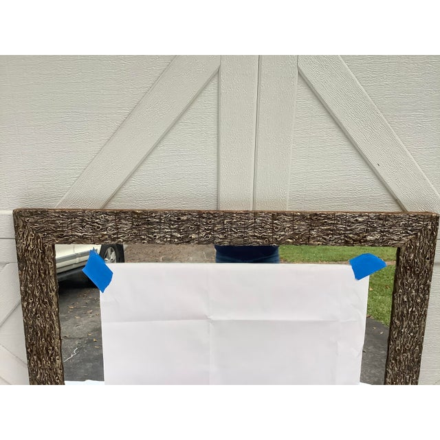 Most unusual pine frame mirror w/ a faux bois motif. The frame is early 20th century, with a newer mirror added. The frame...