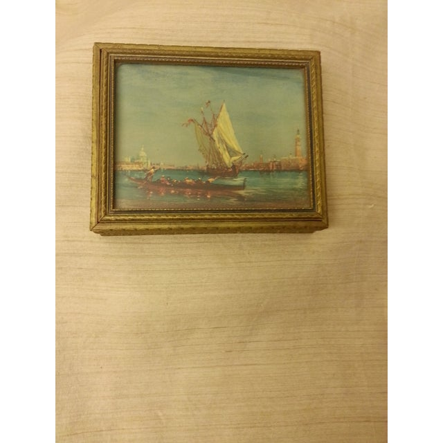 This lovely gold painted wooden box features a charming print of the waterways in Venice under glass. This box shows no...