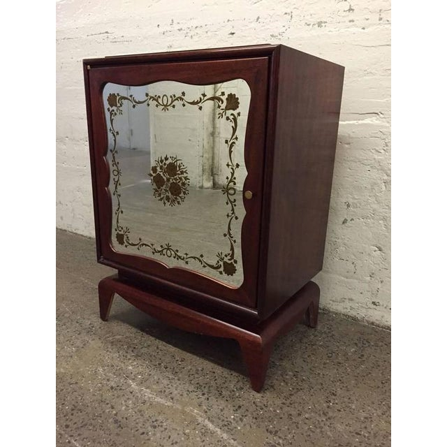 Pair of mahogany Grosfeld House cabinets with etched mirrored panels. Has a single adjustable glass shelf inside.