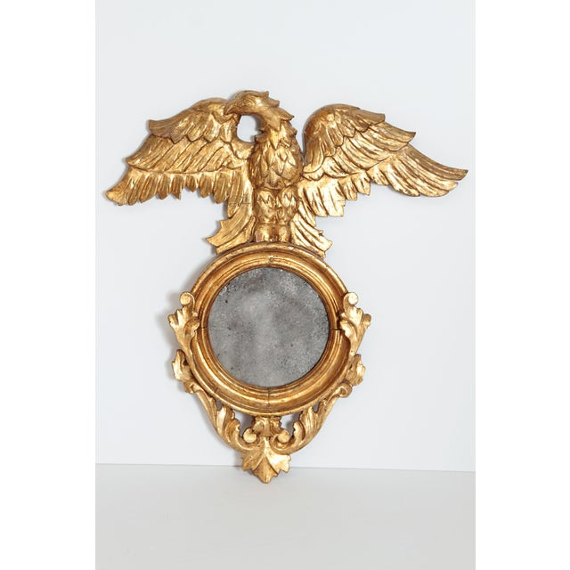 a pair carved and gilded mirrors, round with distressed / old plate, FLAT, NOT CONVEX, each topped with a large eagle,...