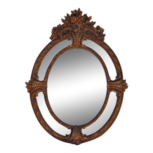 (YOU CAN MAKE REASONABLE OFFERS.) This is a golden oval mirror. The ornate mirror has been designed to look like an...