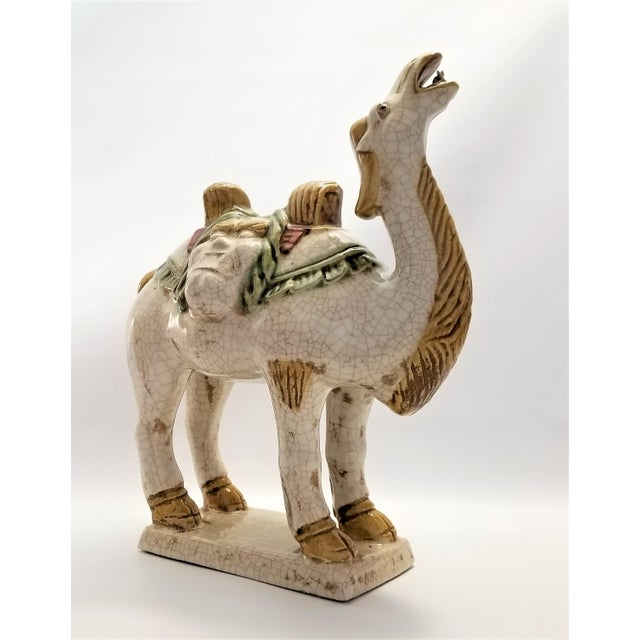 Offering a dynamic vintage Chinese Tang style ceramic camel statue, circa 1970s. This particular sculpture is quite heavy...