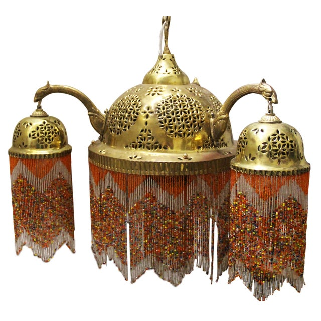 Gorgeous pendant light to spice up your decor! Detailed bead work and pierced brass are hallmarks of this vintage moroccan...