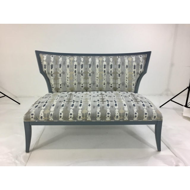 Stylish Modern Currey & Co. Garbo Settee/Bench, blue-gray frame with a blue, gray, white, and champagne abstract fabric,...