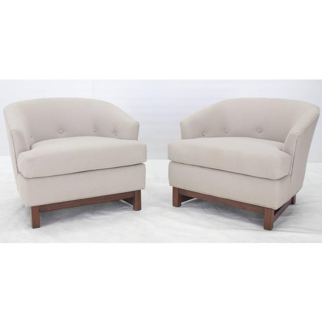 Pair of barrel back walnut frames legs new upholstery lounge chairs.
