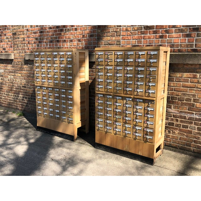 A rare pair of mid-century library card catalog cabinets procured from the library at Western Michigan University. The...