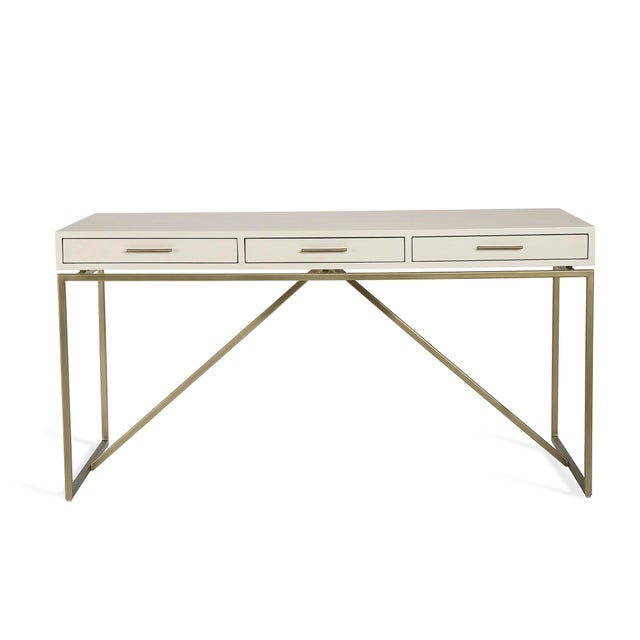 Thanks to white faux snakeskin and iron finished in champagne silver, the seriously chic Emmet Snakeskin Desk is a...