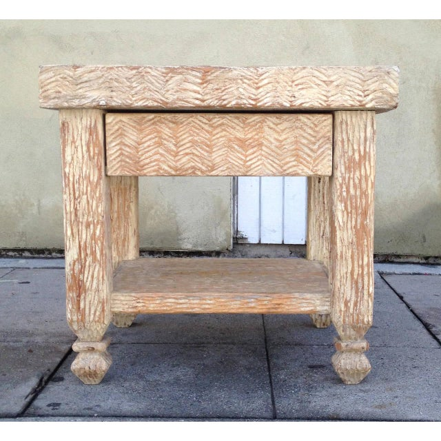 This pair of hand-carved side tables features sturdy wooden frames with an uneven texture throughout. The two-tiered...