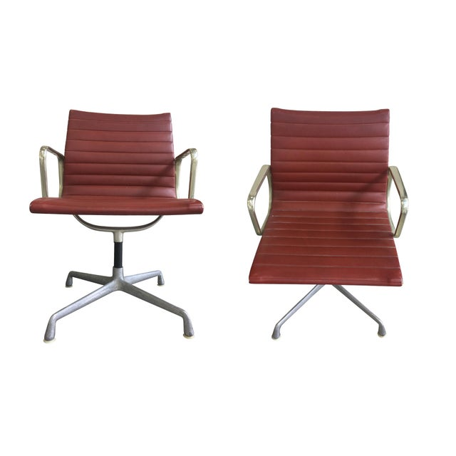 Original set of six swivel arm chairs designed by Ray and Charles Eames for Herman Miller. Mid-20th Century. They are...