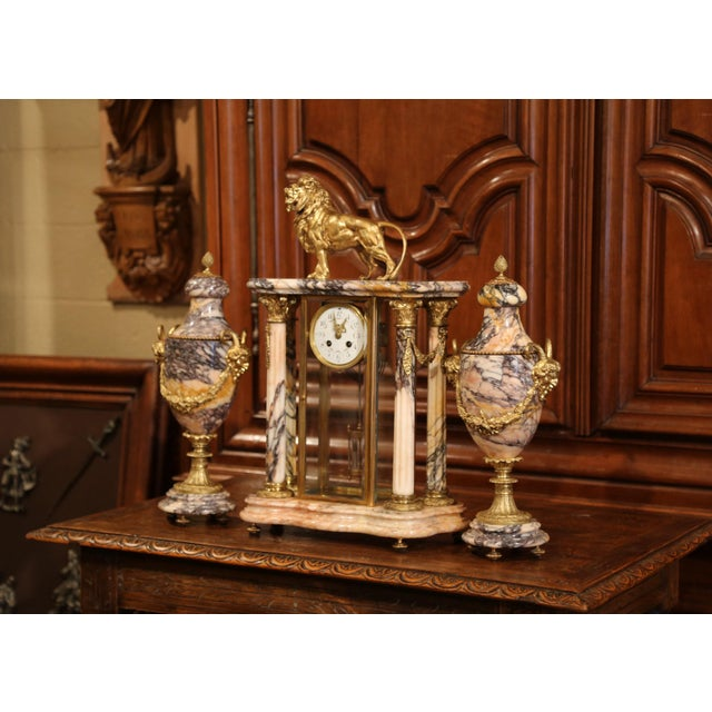Decorate your mantel with this antique Empire clock garniture set from Paris crafted, circa 1860, the time keeper features...