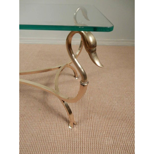 Best quality workmanship on French brass swan headed coffee table with glass top. Almost no seams with splayed feet...