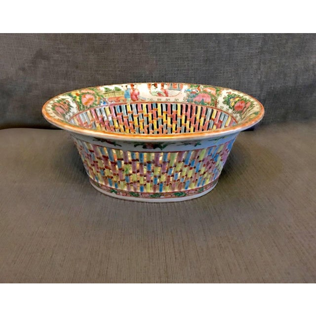 This is a classic example of a mid-19th century Chinese Export reticulated fruit or chestnut bowl with its original...
