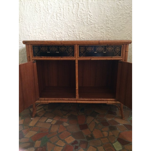 Vintage 1960's Painted Bamboo Cabinet with 2 draws and pair of hinged doors. Front and sides of cabinet are black with...