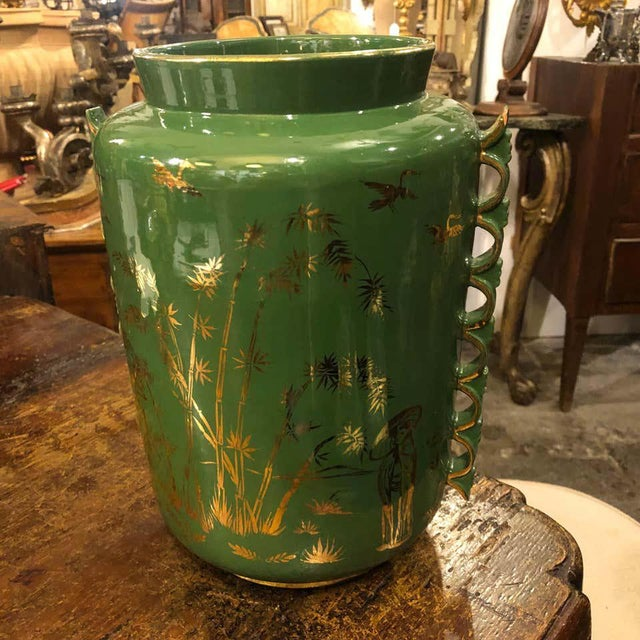 An oriental decorated vase made in Italy in the 1960s. Green and gold ceramic is in good condition. Only a little chip on...